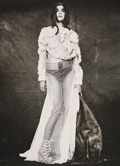 Givenchy Haute Couture by Riccardo Tisci's off-white embroidered silk tulle gown and ivory-embroidered tulle sweater. Roitfeld's own jacket, jewelry, and shoes.