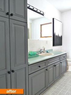 budget reno of 1980s bath: paint light oak cabinets & brass light strip, paint pink walls & tile, change hardware, keep green counter, grey floor & white fixtures for now, hang eyecatching art that goes with cabinet colour, great until can afford whole makeover