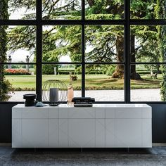 Tropez SIDEBOARD by CATTELAN ITALIA  Sideboard with matt white (OP7) or graphite (OP69) lacquered doors and drawers. Feet in transparent methacrylate.   Optional internal shelves in clear glass.  Each shelf +48     http://www.format-store.com/en/prod/living-area/sideboard-and-container/tropez-sideboard-by-cattelan-italia.html