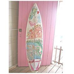 Pink surf board and door