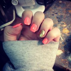 Coral and gold sparkle acrylic nails. I love them :)