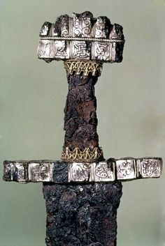 Hilt of a Viking Sword C, Hedeby, Denmark. Weapons and armour were huge status symbols. Vikings gave their ornate swords names like Legbiter but when a warrior died in battle his sword was ritually killed too – bent double, and interred with him. Viking Life, Viking Art, Viking Woman, Alfred Le Grand, Les Runes, Sword Hilt, Viking Sword, Viking Culture, Norse Vikings