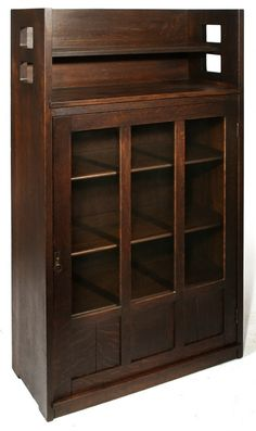 """LIMBERT early cut-out single door bookcase, gallery top, adjustable shelves, excellent original dark red brown finish. Signed with early paper label. Very good condition. 64"""" H x 32"""" W x 14 1/2"""" D."""