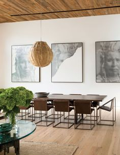 Three paintings by Santa Monica-based artist Alison Van Pelt, above a Lawson-Fenning dining table. The chairs are vintage, purchased from a friend, which she then had copied.