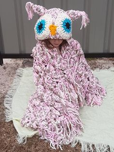 This is a pattern for a Bulky & Quick Owl Blanket which comes in Child and Adult size.This Blanket is designed as a gorgeous hooded fringe throw. Wrap yourself up, forget your worries and be the owl! Or simply lay the blanket over top and admire your cozy owl Blanket. When not in use tuck into a pillow. This fun whimsical design will make any owl fans day and makes the perfect gift!The yarn is held double for the blanket and single for the eyes and other trimming.