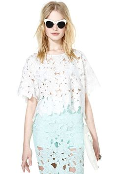 The perfect lace cut-out top for spring.   NastyGal Petal Punch top, $48