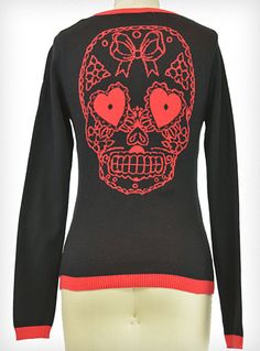 Scarlet Sugar Skull Cardigan | This wicked cardigan sweater is a must have for any season! It features a black background with a large red bow woven into the chest, red trim at the neckline, hem, and sleeves, and a huge red sugar skull with heart shaped eyes woven into the back - too cute- PLASTICLAND
