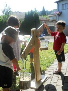 Large home made balance scale for the playscape? This would be very cool in sand canyon,