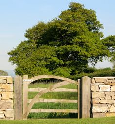 Everything about this gate says artisan. And beautiful. And classic. It's a handmade cleft-oak gate, made from a tree that is cleft (split) and then trimmed to size and attached to solid oak posts. The dry-laid stone wall continues the artisanal feel for a look that sums up the quintessential British countryside in a nutshell.