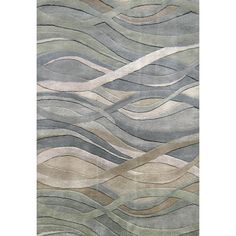 Add a soothing, contemporary accent to your living space with this silver New Zealand wool rug. Constructed from 100 percent wool, this rug features cool accents of blue, green, rust, and silver that resemble the peaceful flow of waves or wind.
