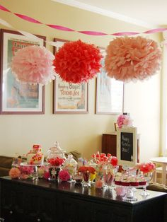 Party Table: Party Table with Giant Pom Poms and beautiful Bon bon dishes full of candies! Perfect little girly party decorations!