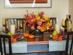 Create a floral centerpiece fit for Thanksgiving by adding berries or mini pumpkins to an arrangement of red, orange and yellow flowers.