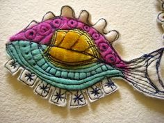 Fish - lots of beautiful embroidered felt ideas on this site.