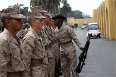 Recruits of Company M, 3rd Recruit Training Battalion, are inspected by Sgt. Detren C. Tate, drill instructor, Plt. 3262, during their series commander inspection aboard Marine Corps Recruit Depot San Diego, Sept. 10. Recruits were inspected for their bearing, uniforms and Marine knowledge.