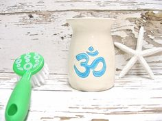 Om Aum Ohm vase yoga toothbrush holder handmade by SeamariesBounty