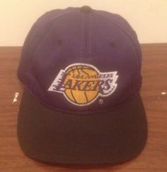 Up for purchase is a Vintage Los Angeles Lakers Snapback Cap.  Made in: Sri Lanka  Made by: Sports Specialties Material: Not Available  Size: One Size Fits All Condition: Great Overall Condition. Minor Yellow on the sweat band inside the hat. One of the snaps is bent. There are not to many of these floating a around anymore! #VinatgeSnapback #Lakers #NBA #Christmas #Vintage #BlackFriday