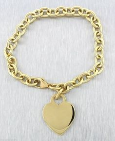 Authentic Tiffany & Co 18K Yellow Gold Heart Tag Charm Bracelet. Get the lowest price on Authentic Tiffany & Co 18K Yellow Gold Heart Tag Charm Bracelet and other fabulous designer clothing and accessories! Shop Tradesy now