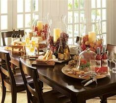 wine and cheese theme party with large hurricane centerpieces