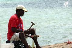 Cracking the conch. Bimini, Bahamas.  #Caribbean #Bahamas #Travel