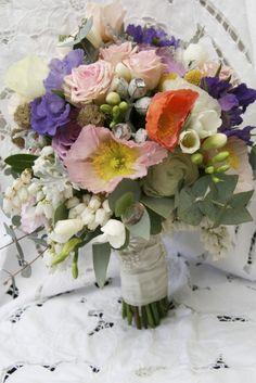 sunshine coast wedding florist | Ginger Lily & Rose Floral Studio | spring time bouquet of multicoloured blooms and argyle apple gum