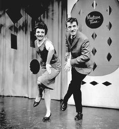 """In May 1960, dancers Joan Darby and Joe Cash perform the Madison dance, a popular line dance that featured different steps such as """"the Jack..."""