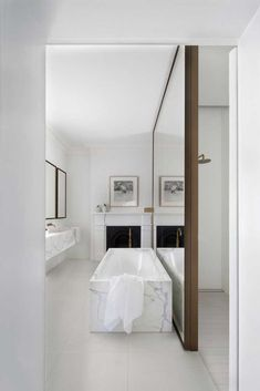 Design Studio Masterfully Bridges 150 Years of Architecture & Design White marble bathroom by Smart Design Studio.Photo by Sharrin Rees.White marble bathroom by Smart Design Studio.Photo by Sharrin Rees. White Marble Bathrooms, Small Bathroom, Marble Bathtub, Bathroom Ideas, Bathroom Mirrors, Big Mirrors, Bathroom Designs, Giant Mirror, Huge Mirror