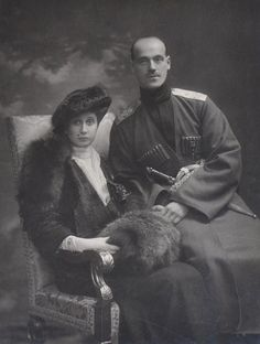 Grand Duke Mikhail Aleksandrovich and his morganatic wife Natalia Sheremetievskya later Countess Brasova. A formal portrait taken on their return to Russia.  (It appears there's something on Natalia's face, but it's actually just a single spot on her veil. Not at all unusual for the fashion of the day, but it makes me sort of crazy; I had to force myself not to Photoshop it out, dear readers!