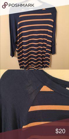 Lularoe Randy shirt Lularoe Randy shirt has a stain shown on picture LuLaRoe Other
