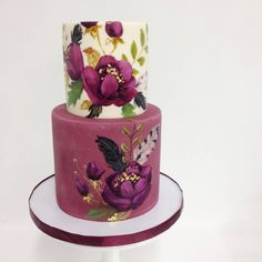 The finished #handpainted #floral and #feathers #cake with touched if #goldleaf. #sweetandsaucyshop #sweetandsaucy #fondant #dessert