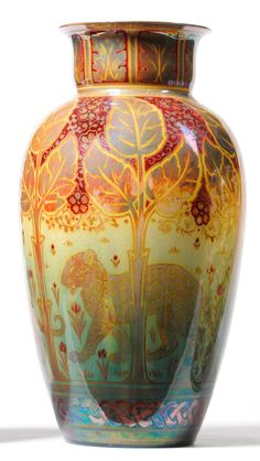 A Pilkington's Royal Lancastrian Lustre Vase, decorated by Richard Joyce, painted with three big cats walking amongst foliage within repeating borders, on a red, yellow, green and lustre ground, artist's monogram within a square, with a stag year mark for 1909, impressed factory mark, 30cm - See more at: http://www.tennants.co.uk/Catalogue/Lots/88681.aspx#sthash.ZJdvwwEQ.dpuf