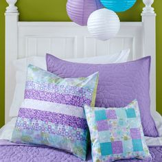 Geometric patterns in springtime colors take center stage on this delightful pillow duet.