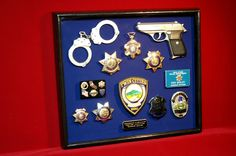 A retired police officer had this made for himself. It chronicles his career over 30+ years and includes his service weapon in the shadow box. www.ShadowBoxUSA.com