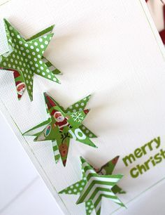 handmade Christmas card ... luv the green patterned paper stars with top layer folded up ... clean graphic look .. fun card!!