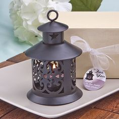 The tables are set with these fabulous black or white metal lanterns used as a favor and they beautifully illuminate your table to cast a romantic light on all.This would be wonderful to hang in groupings as a centerpiece for your wedding or shower, or any event.