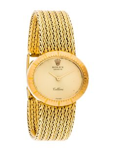 18K yellow gold 23mmx25mm Rolex Cellini watch featuring a manual movement with smooth bezel, gold-tone silvered dial, 18K yellow gold link bracelet and hinged clasp closure.