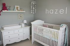 I am kinda of in love with the gray wall, white furniture and fluttery mobile :)