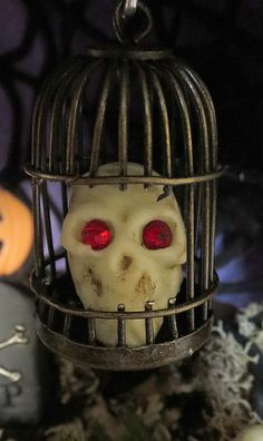 Molded mini skull with glowing gem eyes - great for Halloween - made with Makin's Clay® no bake, air dry polymer clay by Pat Krauchune - http://www.makinsclayblog.blogspot.com/2015/10/delve-into-depths-of-this-awesome.html