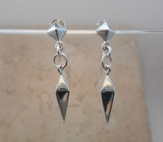 """These Sterling Silver beauties are bold and abstract.  Elegant enough for that important evening out and fun enough to wear everyday!         THE DETAILS ON THIS PIECE:  - Sterling Silver Pyramid Stud Post - Sterling Silver Spike Dangle is 23.5mm long x 5mm wide (.93"""" x .20"""") - Overall length: 1-5/8""""  *All measurements are approximated.  Arrives beautifully gift boxed.  E-315"""