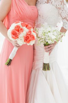 Coral bridesmaid dress with white bouquet and coral rose touches.