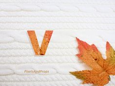 Lowercase letter v with glitter leaf and sweater knit. #fall #autumn #alphabet #typography #initial #monogram #font | maple leaf