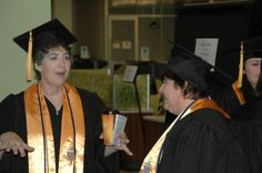April Albrecht, left, and Mary DeWitt, both of Union, visit while they wait for East Central College's commencement exercises to begin on Saturday morning. Graduates gathered and lined up for the processional in the library and marched to the gymnasium for the ceremony.