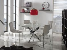 Contemporary glass round dining table with a choice of high gloss white or chrome legs