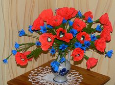 Flowers from crepe paper. Poppies and cornflowers.