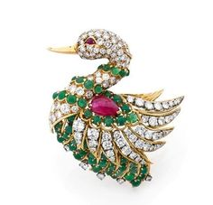 A RARE DIAMOND, EMERALD, RUBY, PLATINUM AND GOLD BROOCH BY VAN CLEEF & ARPELS, CIRCA 1980
