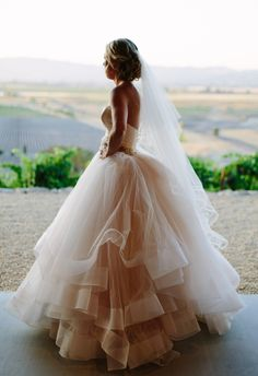 White ballgown, sweetheart neckline, skirt with layers of tulle // Megan Clouse Photography