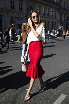 We are oh-so smitten with this street style star's romantic look. We love how her flirty lace off-the shoulder top is neatly tucked into her red body-con skirt with a flared hem and accessorized with a simple nude bag and showstopping Valentino rockstud metallic pumps. The best part is that this look is suitable for a daytime and nighttime date.