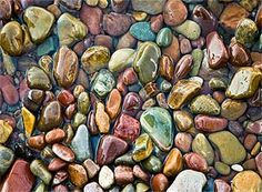 Pebbles by Tom and Ellen Judd, via juddpage.com. (On the western side of Glacier NP is Lake McDonald. Slightly larger than St. Mary Lake, McDonald's southwestern shore is a spectacular jewel case of multi-colored and smoothly polished rocks.)