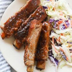 """""""These mouthwatering, oven-baked St. Louis ribs are fall-off-the bone tender with a flavorful homemade dry rub seasoning. Oven roasting is a great way to make ribs without a grill or smoker. These finger-licking ribs are perfect for your next potluck or crowd gathering! St. Louis ribs is what the cut of meat is called, it has more meat in between the bones, as well as fat, as it's from the belly part of the pig. This makes it a flavorful choice for oven-baking"""""""