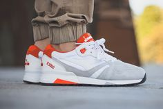 A clean colorway, with vibrant orange inclusions.