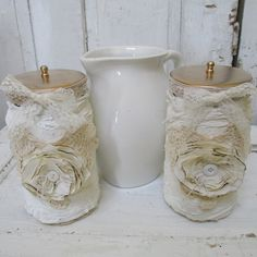 White shabby chic candle jars and pitcher grouping cheesecloth and fabric embellished jars simple home decor anita spero